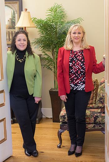 Photo of Patsy and Tara at office door
